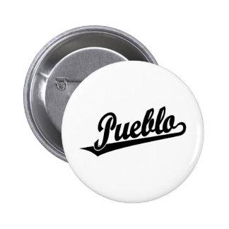Pueblo script logo in black distressed 6 cm round badge