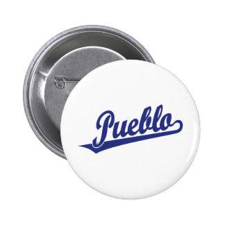 Pueblo script logo in blue 6 cm round badge