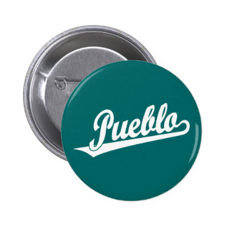 Pueblo script logo in white 6 cm round badge