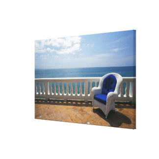 Puerto Rico. Wicker chair and tiled terrace at Gallery Wrapped Canvas