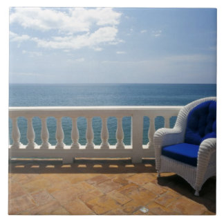 Puerto Rico. Wicker chair and tiled terrace at Large Square Tile