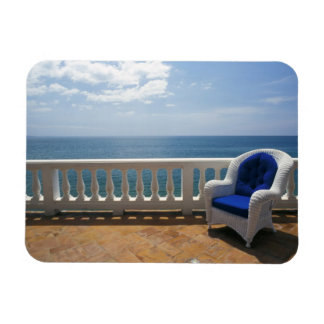 Puerto Rico. Wicker chair and tiled terrace at Magnet
