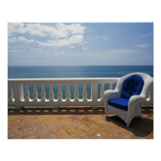 Puerto Rico. Wicker chair and tiled terrace at Poster
