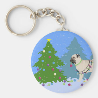 Pug decorating a Christmas Tree in the forest Basic Round Button Key Ring