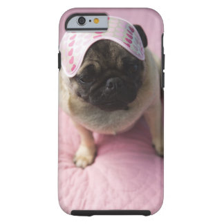 Pug dog with eye mask on head sitting on bed, tough iPhone 6 case