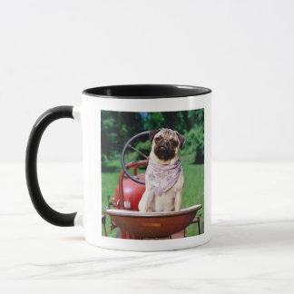 Pug on lawnmower wearing bandana mug