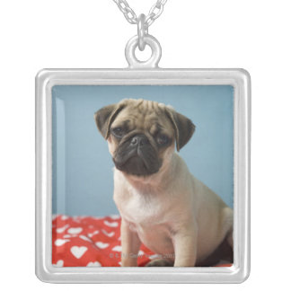Pug puppy sitting on bed square pendant necklace