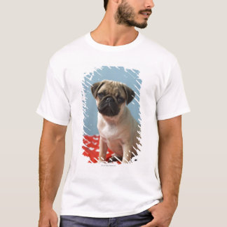Pug puppy sitting on bed T-Shirt