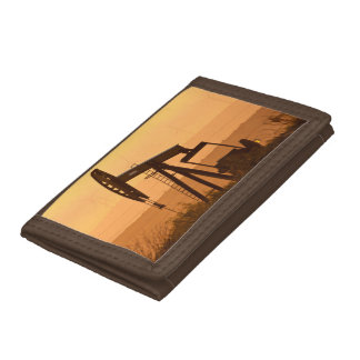 Pump Jack Pumping Oil In West Texas, USA Tri-fold Wallet