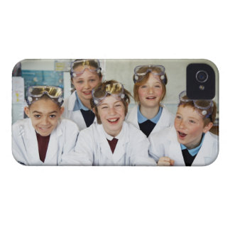 Pupils (9-12) in science class, smiling, iPhone 4 cover