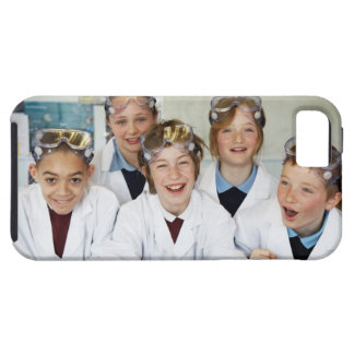 Pupils (9-12) in science class, smiling, tough iPhone 5 case
