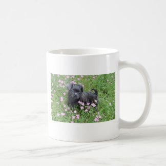 Puppy in a field of wild flowers coffee mug