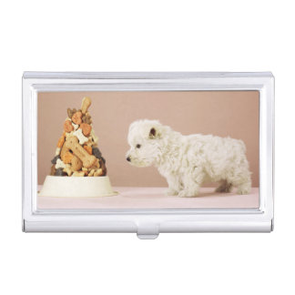Puppy looking at pile of biscuits in dog bowl business card holder