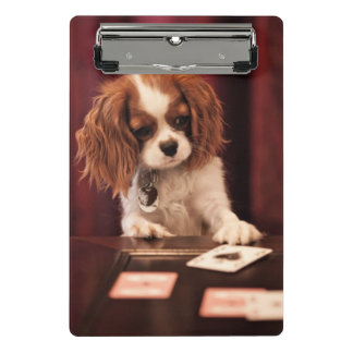 Puppy plays with cards on coffee table. mini clipboard