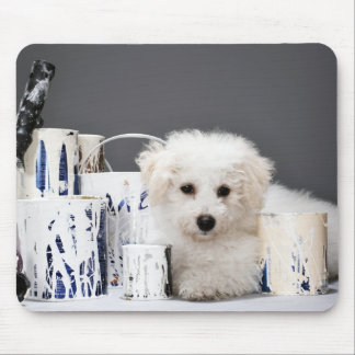 Puppy sitting amongst paint tins mouse pad