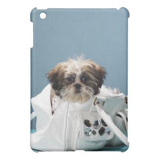 Puppy sitting in handbag iPad mini case