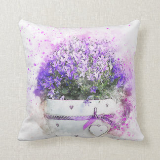 Purple and lavender flowers in pink and white pot cushion