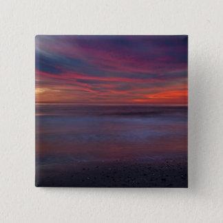 Purple-colored sunrise on ocean shore 15 cm square badge