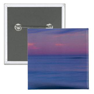 Purple-colored sunrise on ocean shore 2 15 cm square badge