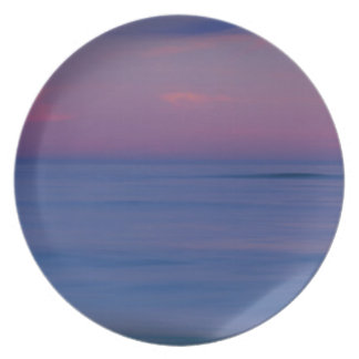 Purple-colored sunrise on ocean shore 2 plate