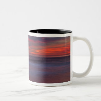 Purple-colored sunrise on ocean shore Two-Tone coffee mug