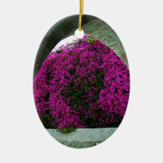 Purple flowers through an arch. christmas ornament