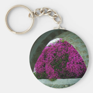 Purple flowers through an arch. keychains