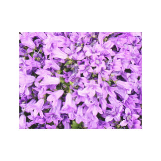 Purple flowers with rain drops stretched canvas print