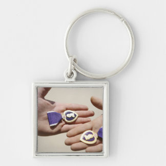 Purple Heart recipients display their medals Silver-Colored Square Key Ring