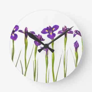 Purple irises isolated on a white background round clock