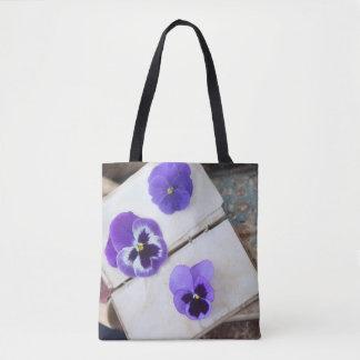 Purple pansies on old book pages tote bag