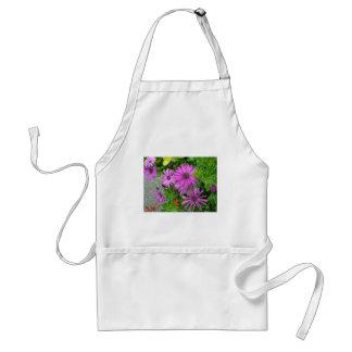 Purple petals amongst the greenery apron