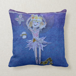 purple pillow adorned with a dancing fairie