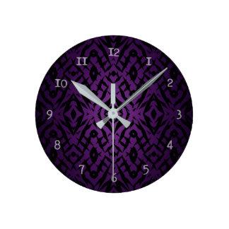 Purple tribal shapes pattern round clock