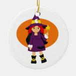 Purple witch cartoon orange behind christmas ornament