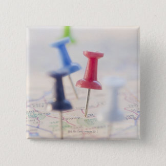 Pushpins in a map 15 cm square badge