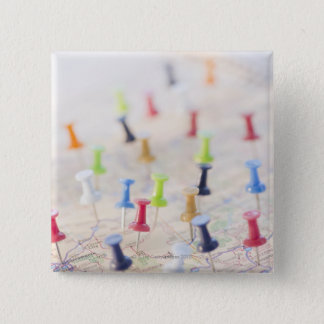 Pushpins in a map 2 15 cm square badge