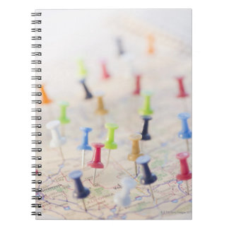 Pushpins in a map 2 notebook