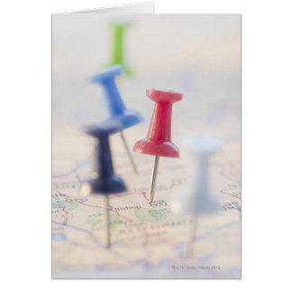 Pushpins in a map card