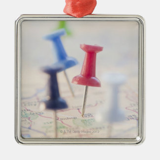 Pushpins in a map christmas ornament