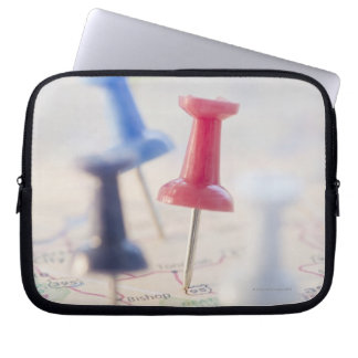 Pushpins in a map laptop sleeve