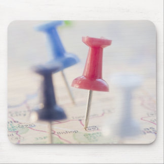 Pushpins in a map mouse mat