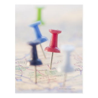 Pushpins in a map postcard