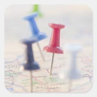 Pushpins in a map square sticker