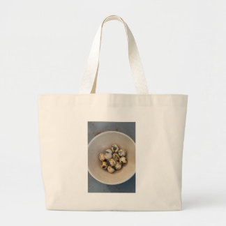 Quails eggs in a bowl large tote bag