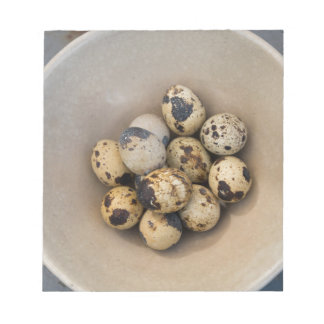 Quails eggs in a bowl notepad