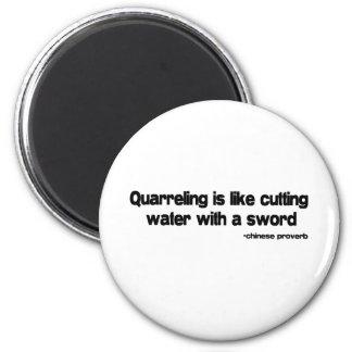 Quarreling quote 6 cm round magnet