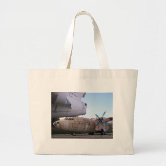 Queing never to fly again. tote bags