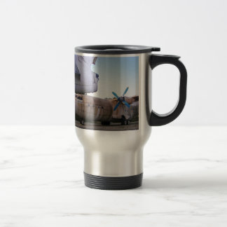 Queing never to fly again. travel mug