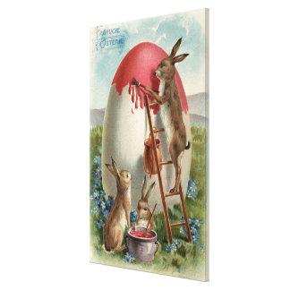 Rabbits Painting an Egg Canvas Print
